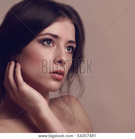 Beautiful Woman Looking Dramatic. Vintage Closeup Portrait