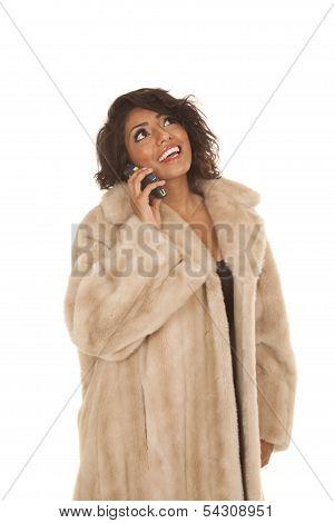 Hispanic Woman Fur Coat Phone Smile Look Up