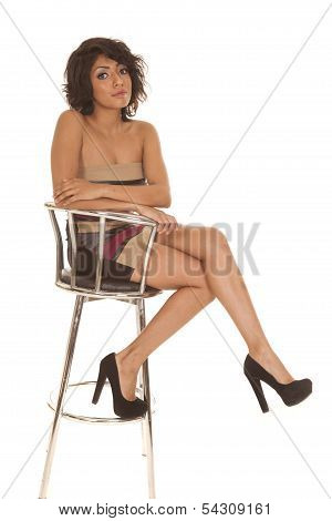 Hispanic Woman Sit Dress Heels