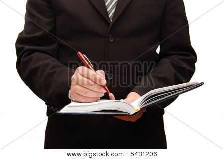 Business Man Filling Out Paperwork