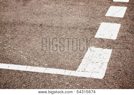 Broken White Painted Lines On Roadway Depicting Yield Instruction