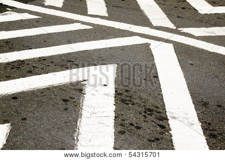 White Painted Pedestrian Crossing On Tarmac Roadway