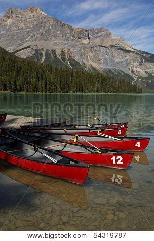 Canoes On Mountain Lake