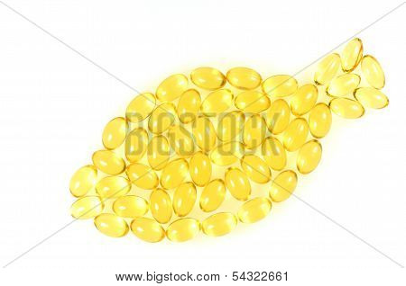symbol of fish made of fish oil capsules isolated on white background