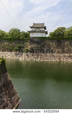 Fragments Of Osaka Castle With Big Moat In The Foreground In Osaka, Japan.