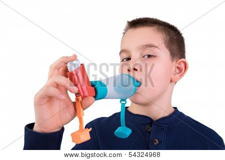 Kid Using Inhaler With Spacer