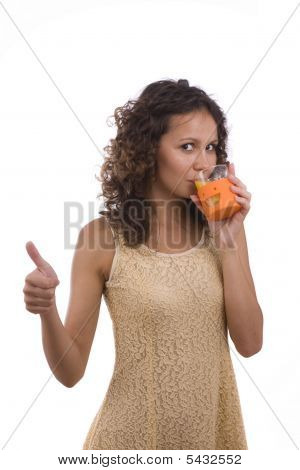 Woman Is Drinking Orange Juice And Showing Ok.