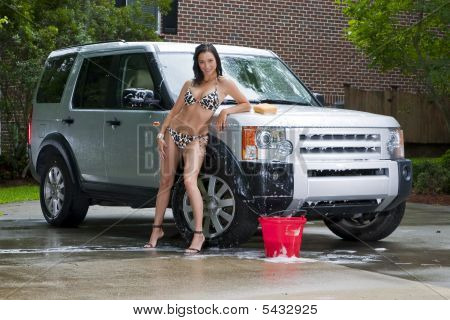 Brunette Model Washing Car