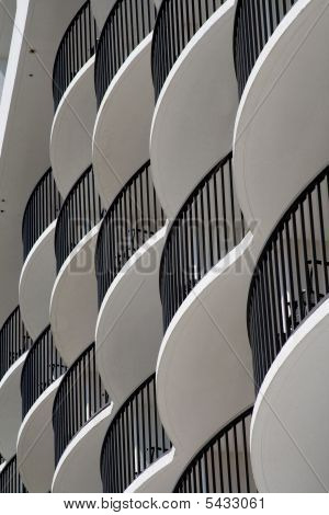 Curved White Hotel Balconies With Black Iron Railings