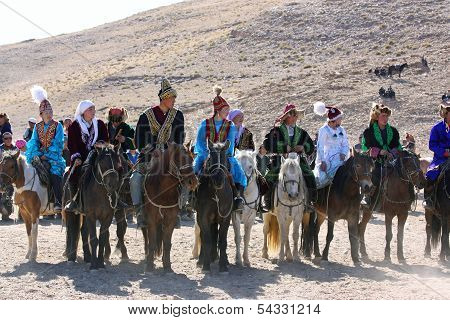 Mongolia - 25 July: Senior Mongolians Horsemen In Traditional Clothing With Golden Eagles During The