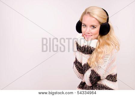 Winter girl with earmuffs.