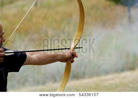 Man Shooting With Bow
