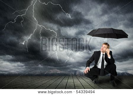Man In A Suit And Umbrella Seeks Shelter From A Storm