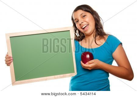 Pretty Hispanic Girl Holding Blank Chalkboard And Apple