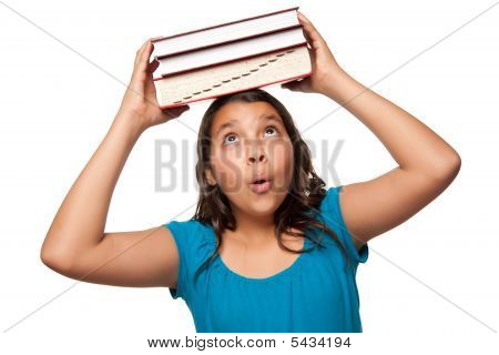 Pretty Hispanic Girl With Books On Her Head