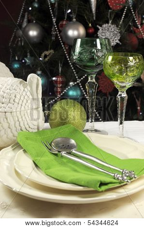 Beautiful Christmas Table Setting with Green Crystal Wine Goblet Glasses