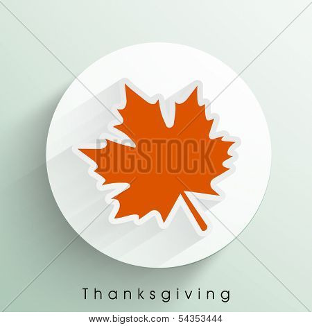 Beautiful Happy Thanksgiving Day celebrations sticker, tag or label wit orange autumn leaf.