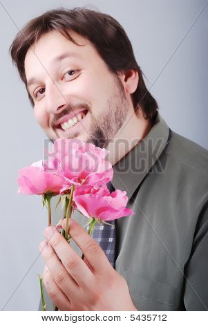Cute Man Offering Pink Roses