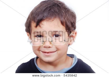 Smiling Child With Glasses