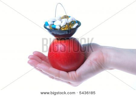 Hand, Apple And Pills