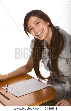 Friendly Excited Asian College Student By Desk