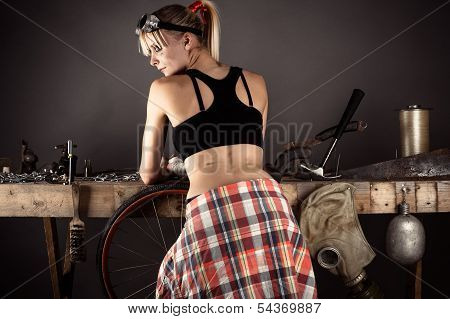 beautiful woman standing near the a workbench