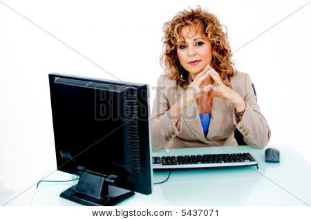 Corporate Feminine At Her Desk