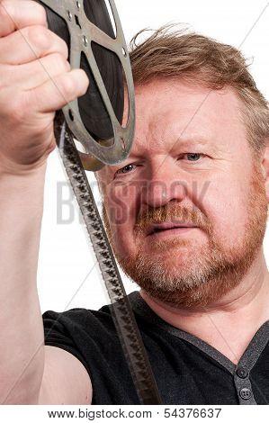 Man Inspecting Film Frames