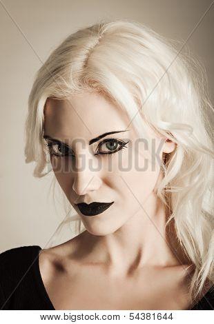Studio Portrait Of Beautiful Vamp Girl. Closeup