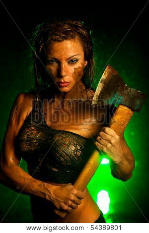 Young strong woman with axe.