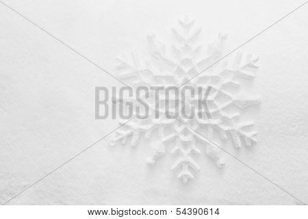 Winter, Christmas minimal elegant background. Snowflake on snow, low contrast image.