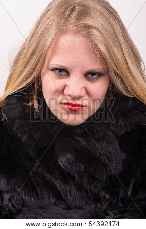 Cocky Angry Young Cute Young Woman In Fur Jacket