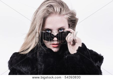 Snobbish Upper Class Girl In Dark Sunglasses And Fur