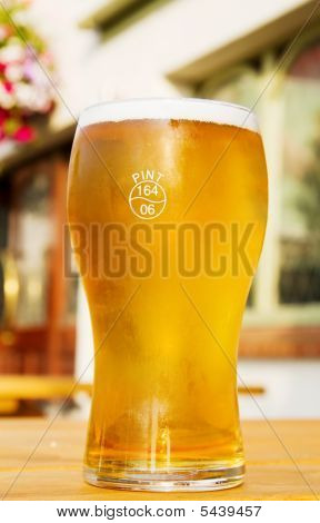 Pint Of Frosted Golden Beer At The Irish Pub