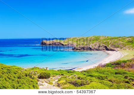Platja del Tortuga beach in sunny day at Menorca island, Spain.