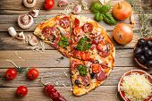 pic of take out pizza  - Sausage pizza on the rustic wooden table - JPG