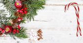 image of candy cane border  - Natural snowy winter background with candy canes and gingerbread cookie - JPG