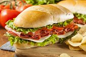 stock photo of tomato sandwich  - Homemade Italian Sub Sandwich with Salami Tomato and Lettuce - JPG