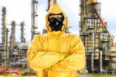 foto of biological hazard  - Man in chemical protective suit over factory - JPG