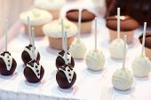 stock photo of cake-ball  - Bride and groom cake pops for a wedding table - JPG