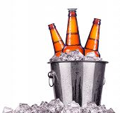 stock photo of bucket  - Beer bottles in ice bucket isolated on white - JPG