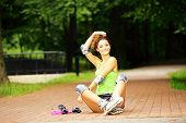 picture of inline skating  - Happy young girl enjoying roller skating rollerblading on inline skates sport in park - JPG