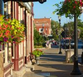 image of quaint  - Colorful sidewalk with quaint shops and flowers in Chagrin Falls Ohio