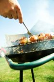 stock photo of bbq party  - Cooking on the barbecue grill. Outdoor weekend time