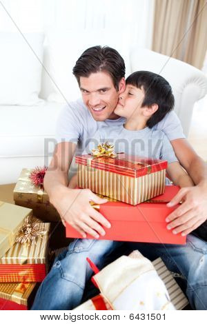 Son Kissing His Father After Receiving A Christmas Gift