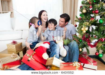 Happy Family Playing With Christmas Gifts