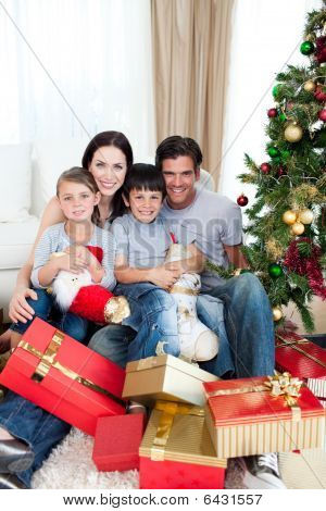 Happy Family With Lots Of Christmas Presents
