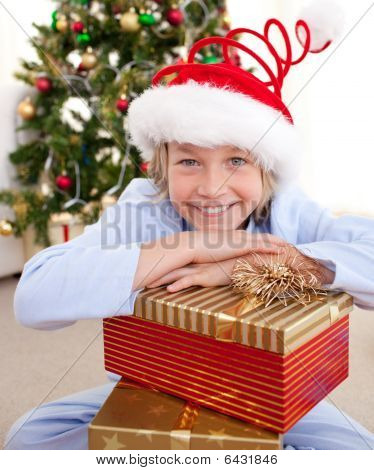 Happy Little Boy With Christmas Presents