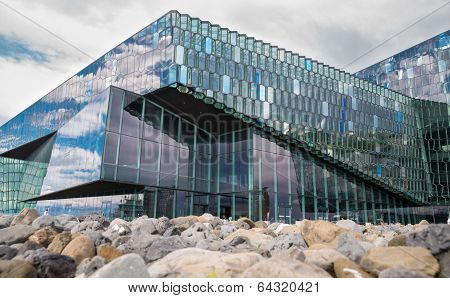 REYKJAVIK, ICELAND - June 19, 2013: Harpa Concert Hall in Reykjavik harbor, Iceland during the day,