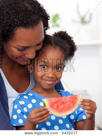 Portrait Of A Smiling Girl Eating Fruit